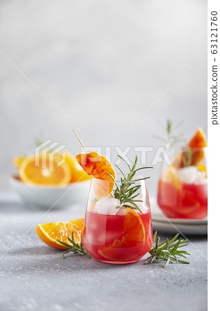 Cocktail with red oranges 63121760