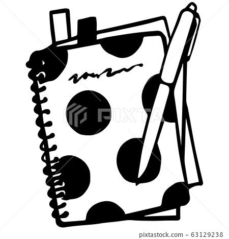 스티커 붙은 도트 무늬의 스케쥴 수첩과 펜 63129238