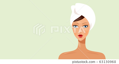 young woman with towel wrapped around her head beautiful girl looking at camera horizontal portrait 63130968