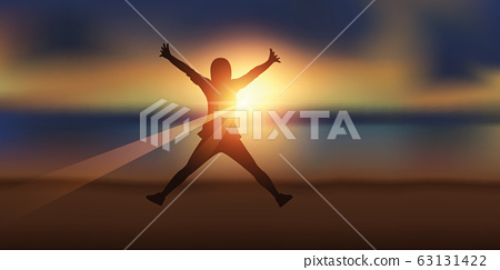 happy girl with raised arms jumps at sunset on the beach 63131422
