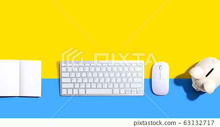 Computer keyboard with a piggy bank and a notebook 63132717