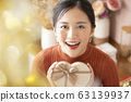 Young woman with gift box 63139937