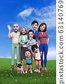 A smiling family waving in the field under the blue sky 63140769
