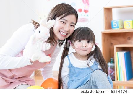 Nursery teachers and girls 63144743