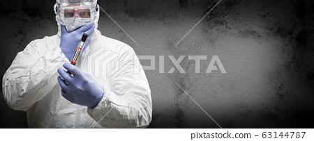 Male Doctor or Nurse In Hazmat Gear Holding 63144787