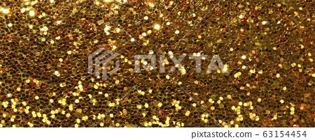 gold glitter sparkle texture background 63154454