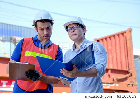 Technician and engineer work together for checking quality and product in cargo container 63162618