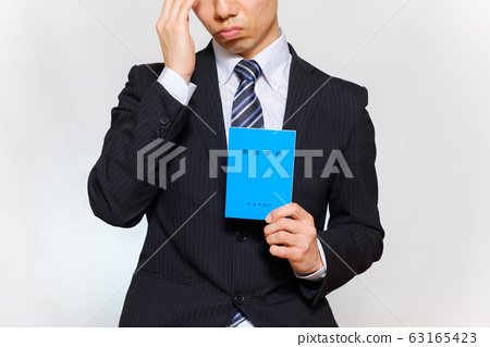 Men in a suit with a pension book 63165423