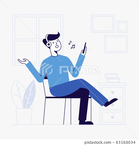 young man listening to music in living room. 63168034