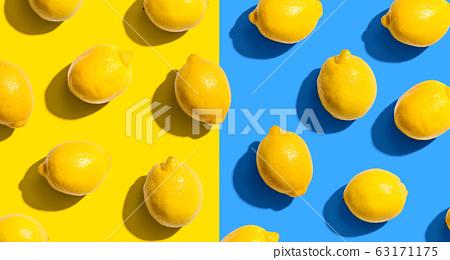 Fresh yellow lemons overhead view 63171175