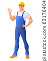 Smiling worker in coveralls showing OK sign. 63178404