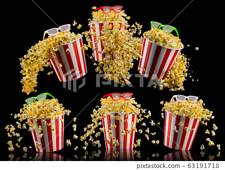 Set of buckets with popcorn and 3D glasses isolated on black background 63191718