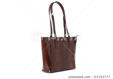 leather female brown bag on the handle sideways on a white background 63192777