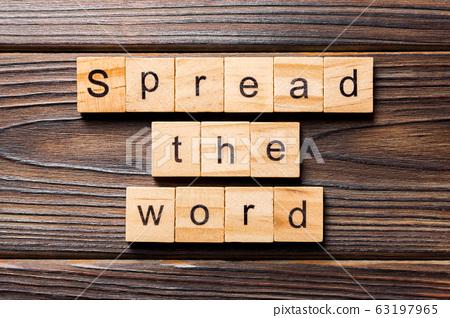 Spread the word word written on wood block. Spread 63197965