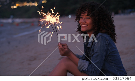 Holiday concept. A beautiful woman playing 63217964