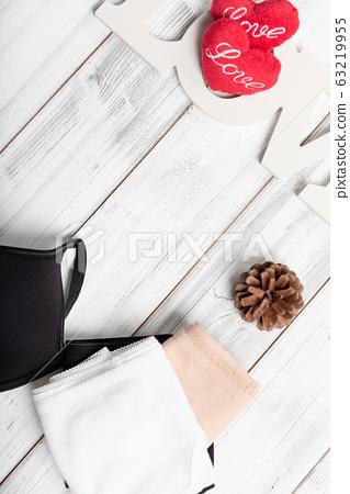 Woman underwear set on white wooden background 63219955