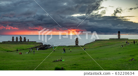 Tahai moais panorama under stormy clouds at sunset 63220634