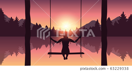 girl on a swing at beautiful purple forest and lake nature landscape at sunrise 63229338