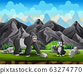 Happy gorilla mother with her baby playing on hill 63274770