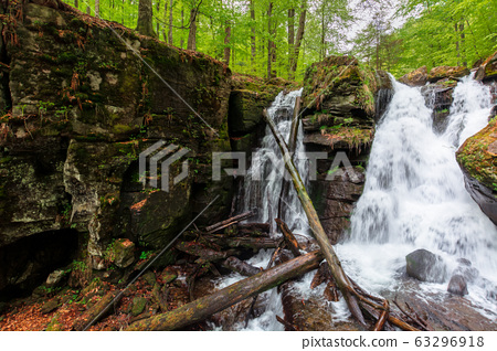 waterfall in the forest. two segment stream. 63296918