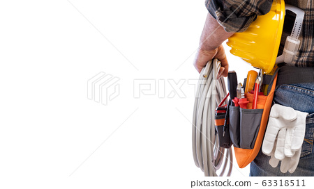 Electrician with tool belt on a white background. 63318511