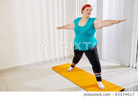 Young woman practicing asana 63334617