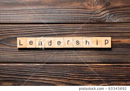 LEADERSHIP word written on wood block. LEADERSHIP 63343692