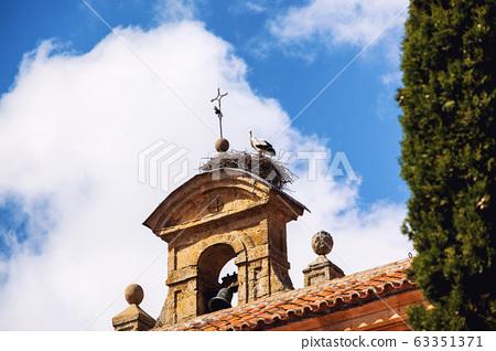Stork's Nest on a steeple of a church in Salamanca, Spain 63351371