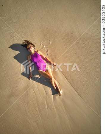 Woman on beach at Seychelles aerial top view 63355408