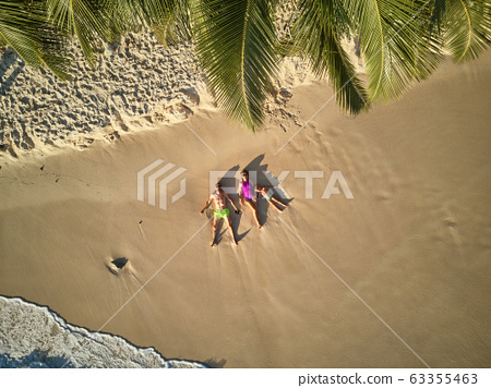 Family on beach at Seychelles aerial top view 63355463