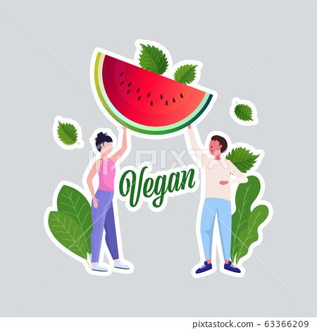 man woman couple holding watermelon healthy lifestyle vegan fresh food vegetarian concept full length 63366209