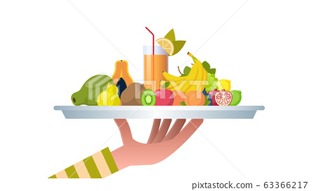 human hand holding glass with orange fruit juice healthy juicy vitamin drink sweet tropical fruits composition in white plate vegan food concept horizontal 63366217
