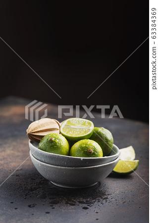 Fresh green limes 63384369