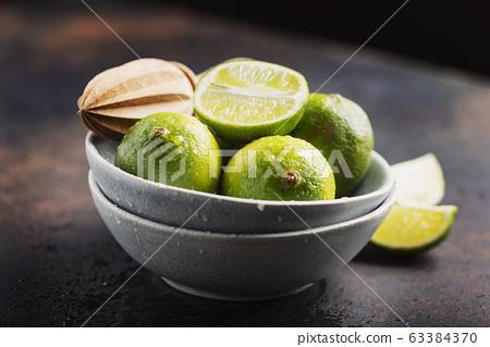 Fresh green limes 63384370