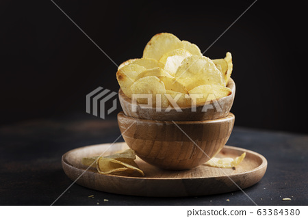Unhealthy potato chips 63384380