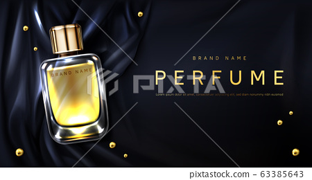 Perfume bottle on black silk fabric background 63385643