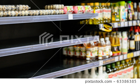 Empty shelves in a grocery store, Hoarding food 63386385