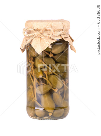 Pickled caper berries in jar isolated on white 63386639