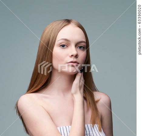 Young pretty woman studio portrait. Cosmetology concept 63390020