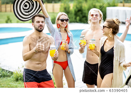 Group of happy friends on the swimming pool 63390405