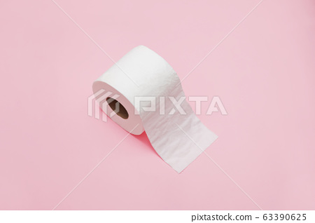 Roll of toilet paper on pink background. 63390625