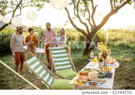 Friends on a picnic in the garden 63394258
