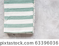 Striped kitchen towels on gray background 63396036