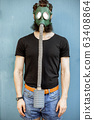 Man with gas mask 63408864