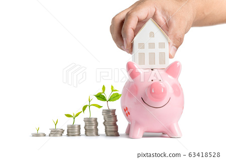 Growing Money - Hand man holding house model on 63418528