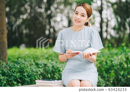 Beautiful woman, park, nature 63428233