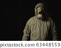 man in a gas mask protects himself from coronavirus 63448559
