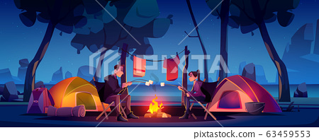 Couple in camp with tent and campfire at night 63459553
