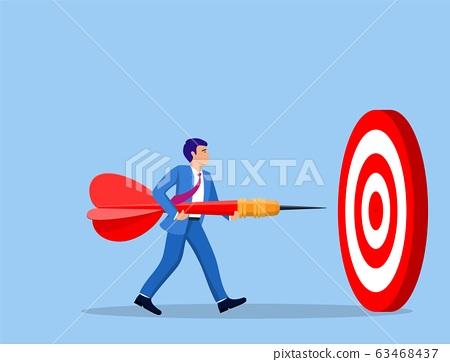 Businessman aim arrow to target. 63468437
