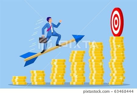 Businessman aim arrow to target 63468444